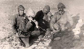 Ottoman soldiers use a field telephone in the desert at the front in Palestine 1917 during World War I (1915-1918)