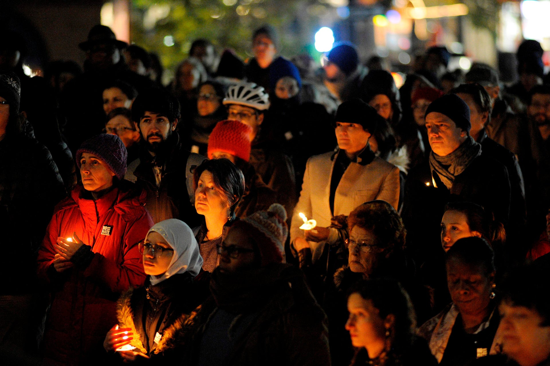 Community members hold candles at a vigil for the victims of the Pittsburgh Synagogue shooting at Cambridge City Hall in Cambridge, Massachusetts on October 30, 2018.