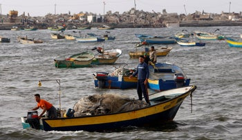 File Photo: Palestinian fishermen leaving the Gaza City's port to fish on the Mediterranean sea, in Gaza City, June 11, 2010.
