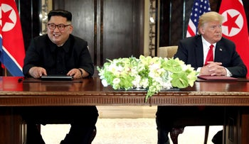 U.S. President Donald Trump and North Korea's leader Kim Jong Un at the conclusion of their summit in Singapore, June 12, 2018.