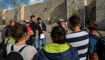 Tourists listening to their guides on the first-of-its-kind dual narrative tour of Jerusalem.