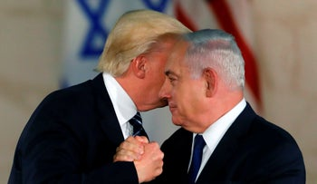 US President Donald Trump (L) shakes hands with Israel's Prime Minister Benjamin Netanyahu during a visit to the Israel Museum in Jerusalem on May 23, 2017