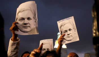 Supporters of WikiLeaks founder Julian Assange demonstrate in front of presidential palace regarding his Ecuadorian citizenship, in Quito, Ecuador, October 31, 2018.