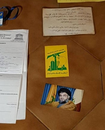 A photograph of Lebanon's Hezbollah leader Sayyed Hassan Nasrallah is seen among things found by Argentine police.