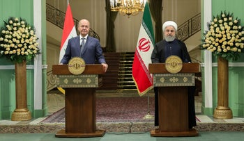 Iraq President Barham Salih and Iran President Hassan Rohani during a press conference in Tehran, November 17, 2018.
