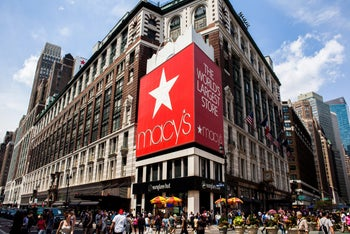 Pedestrians and shoppers pass in front of a Macy's Inc. store in New York, U.S. July 18, 2016
