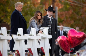 Donald Trump and Melania Trump, alongside Rabbi Jeffrey Myers, place stones and flowers on a memorial at the Tree of Life Synagogue following the shooting in Pittsburgh, Pennsylvania. October 30, 2018