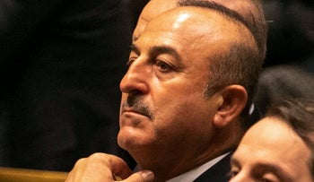 Mevlut Cavusoglu, Turkey's foreign affairs minister, listens during the UN General Assembly meeting in New York, U.S., on Tuesday, Sept. 25, 2018.