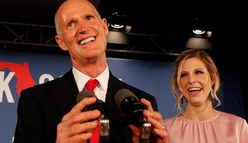 FILE PHOTO: Republican U.S. Senate candidate Rick Scott is accompanied by his daughter Allison Guimard as he addresses supporters at his midterm election night party in Naples, Florida, U.S. November 6, 2018.