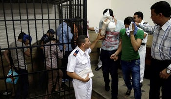 """Egyptian men convicted for """"inciting debauchery"""" following their appearance in a video of an alleged same-sex wedding party on a Nile boat in a courtroom in Cairo, Egypt, November 2014"""