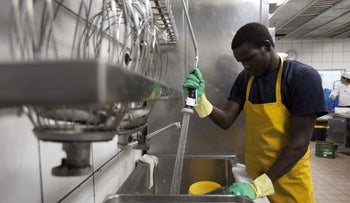 A worker from Sudan at a restaurant in Eilat