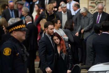 Mourners gather outside Rodef Shalom Temple following the funeral of brothers Cecil Rosenthal, 59, and David Rosenthal, 54 on October 30, 2018 in Pittsburgh, Pennsylvania