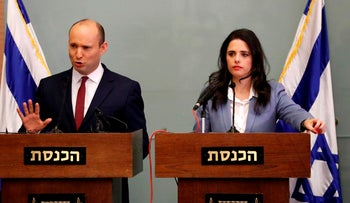 Israeli Education Minister Naftali Bennett, left, speaking as he and Justice Minister Ayelet Shaked give a statement at the Knesset in Jerusalem on November 19, 2018.