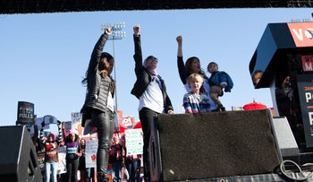 Women's March co-chairs Tamika Mallory Linda Sarsour and Bob Bland cheer during the Women's March One-Year Anniversary: Power To The Polls event in Las Vegas, U.S., on Sunday, January 21, 2018.