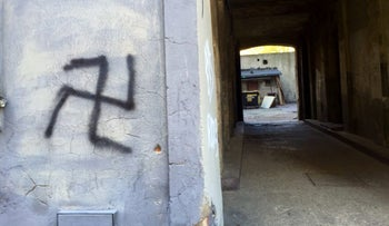 A swastika spray-painted on a wall in Poland.