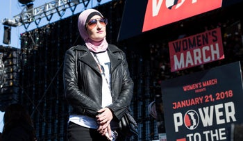 Linda Sarsour, co-chair for the Women's March, listens during the Women's March One-Year Anniversary: Power To The Polls event in Las Vegas, Nevada, U.S., on Sunday, Jan. 21, 2018.