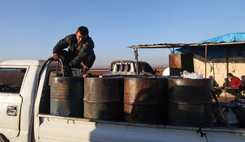 A Syrian man works at a primitive oil facility in the town of Zardana in the countryside of the northwestern Syrian Idlib province, on Thursday, November 1, 2018.