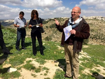 Sami Awad of the Holy Land Trust speaks to Encounter participants on a West Bank hilltop