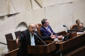 Israeli MK Ahmad Tibi of the Joint List and Knesset Speaker Yuli Edelstein of the Likud party held a special Knesset session on national law.