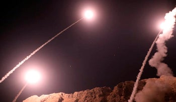 Iranian Revolutionary Guards missiles fired from the city of Kermanshah in western Iran targeting the Islamic State group in Syria, October 1, 2018.