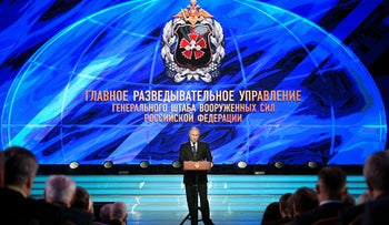 Russian President Vladimir Putin, center, speaks at a meeting with officers of Russia's military intelligence, GRU in Moscow, Russia,, Nov. 2, 2018.