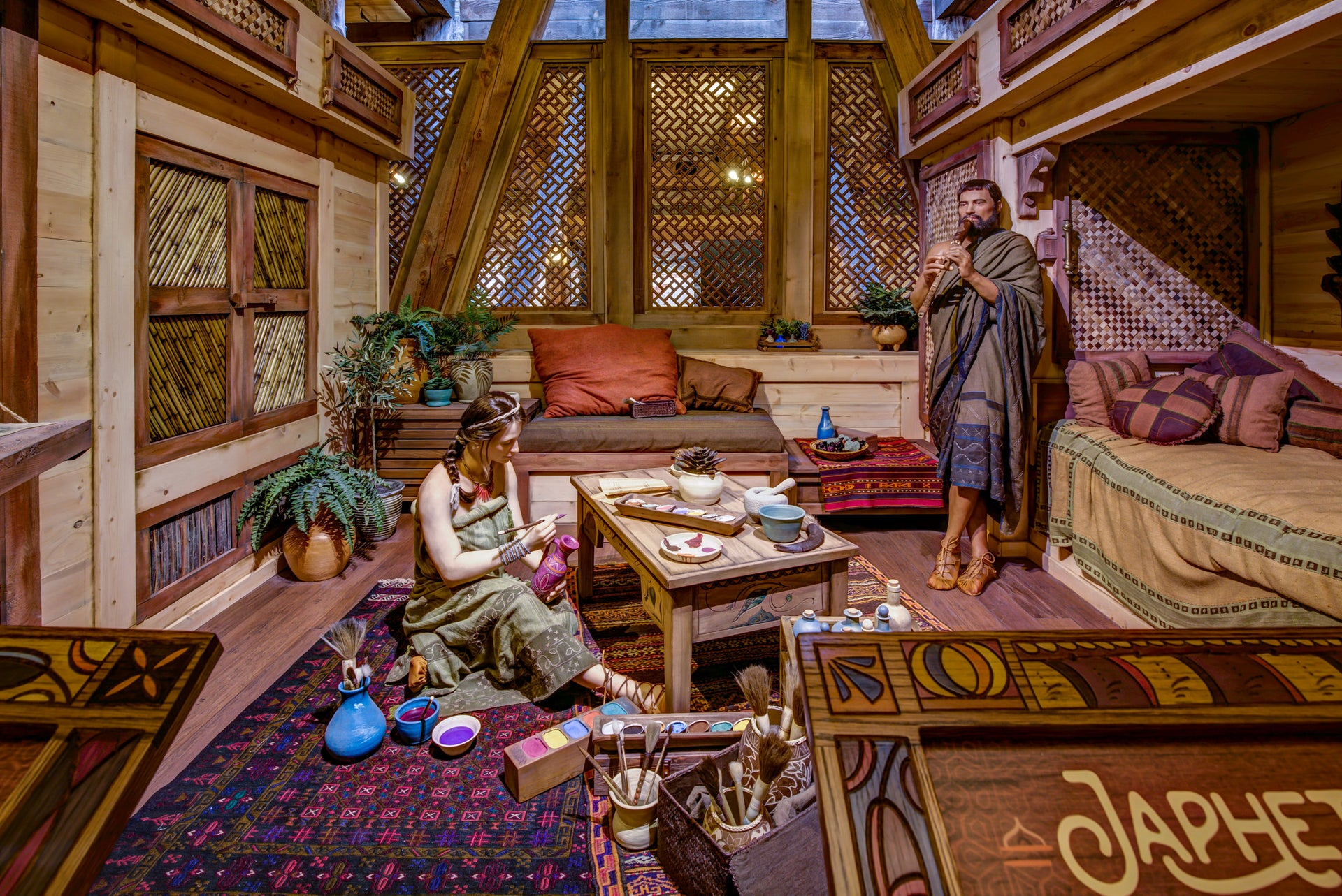 Models of Noah and a family member inside the seven-story Ark.