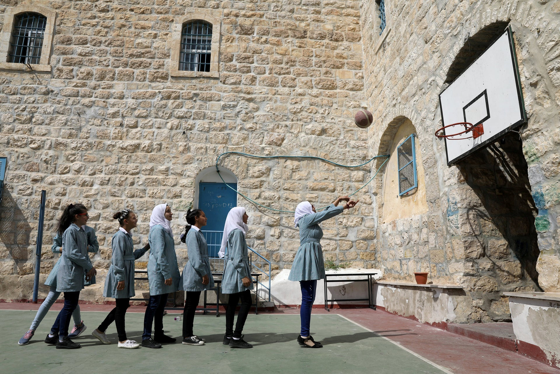 Palestinian schoolgirls play with a ball at school run by UNRWA (United Nations Relief and Works Agency) in Silwan in East Jerusalem October 10, 2018.