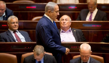 Prime Minister Benjamin Netanyahu walks during an opening session at the Knesset October 15, 2018.