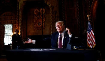 U.S. President Donald Trump speaks via video teleconference with troops from Mar-a-Lago estate in Palm Beach, Florida, U.S., November 22, 2018.