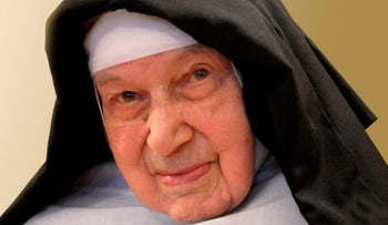 Sister Cecylia Maria Roszak poses for a photo at her monastery in Krakow, Poland, on March 28, 2014.