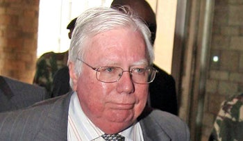 In this Oct. 7, 2008, file photo, Jerome Corsi arrives at the immigration department in Nairobi, Kenya.