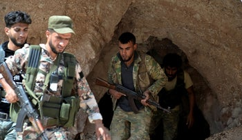 FILE Photo: Fighters with the Free Syrian army in the outskirts of the northern town of Jisr al-Shughur, Syria, west of the city of Idlib, September 9, 2018.
