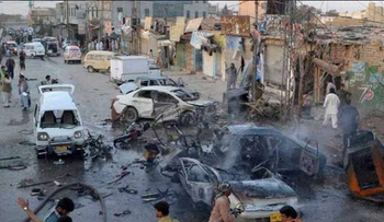 The aftermath of the suicide bombing in a crowded Pakistan market, November 23, 2018.