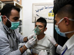 A man receiving oxygen through respirators following a suspected chemical attack on his town of al-Khalidiya, in Aleppo, Syria, Saturday, November 24, 2018.
