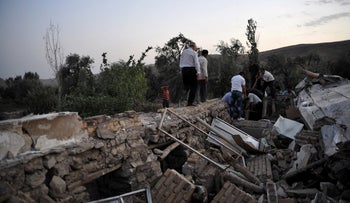 FILE PHOTO: The aftermath of an earthquake in northwestern Iran, August 11, 2012.