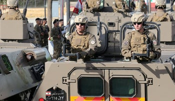 FILE PHOTO: Lebanese security forces take part in a military parade in Beirut, November 22, 2018.