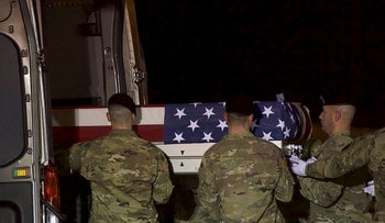 Members of the U.S. military carry a transfer case covered with an American flag during a dignified transfer for fallen service member, Army Ranger Sgt. Leandro A.S. Jasso on November 27, 2018 in Dover, Delaware