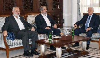 File Photo: Palestinian President Mahmoud Abbas meets with Hamas leaders Khaled Meshal and Ismail Haniyeh, Doha, October 28, 2016.