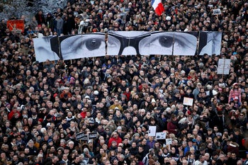 A solidarity march in the streets of Paris in tribute to the victims of the shooting at the offices of Charlie Hebdo on January 11, 2015.