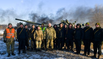 """Ukraine's President Petro Poroshenko (C) poses for a picture with servicemen at the 169th training centre """"Desna"""" of the Ukrainian Army ground forces in Chernihiv Region, Ukraine November 28, 2018"""