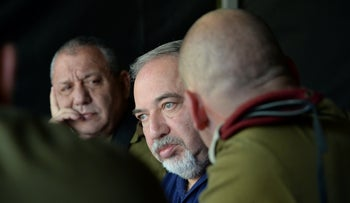 Former Defense Minister Avigdor Lieberman with Chief of Staff Lt. Gen. Gadi Eisenkot during a military exercise in northern Israel, April 2018