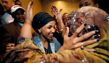 Democratic congressional candidate Ilhan Omar is greeted by her husband's mother after appearing at her midterm election night party in Minneapolis, Minnesota, U.S., November 6, 2018.
