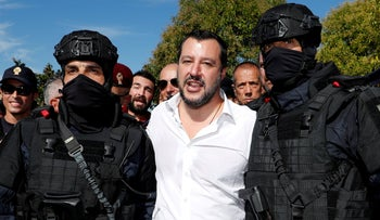 FILE PHOTO: Salvini poses with two members of the Central Security Operations Service in Rome, Italy October 10, 2018
