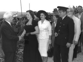 Mary Ben-Gurion (in black) shakes hands with her father-in-law. Amos Ben-Gurion is the man in the police uniform.