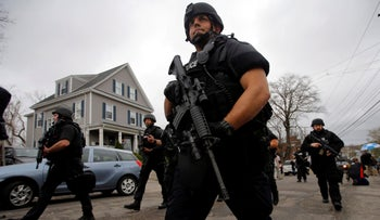 Police officers search house to house for Dzhokhar Tsarnaev, the surviving suspect in the Boston Marathon bombings, in a neighborhood in Watertown, Massachusetts April 19, 2013.