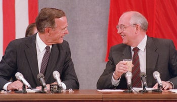 FILE PHOTO: Then-U.S. President George H.W. Bush and Soviet counterpart Mikhail Gorbachev in a joint press conference in Moscow, July 31, 1991