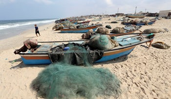 Fishing boats on a beach in the southern Gaza Strip, October 7, 2018.