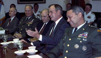 FILE PHOTO: U.S. President George H.W. Bush meets with his military advisors at the Pentagon to discuss the Gulf crisis, in Washington August 15, 1990.