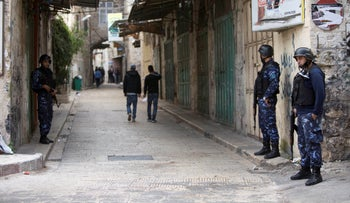 Members of the Palestinian security forces patrol during an ongoing operation to arrest wanted Palestinian gunmen in the old town of the West Bank city of Nablus, Wednesday, November 16, 2016.