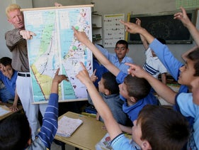 A Palestinian teacher displays a map of Israel and the Palestinian territories during a lesson marking Nakba in the West Bank city of Hebron May 15, 2006.